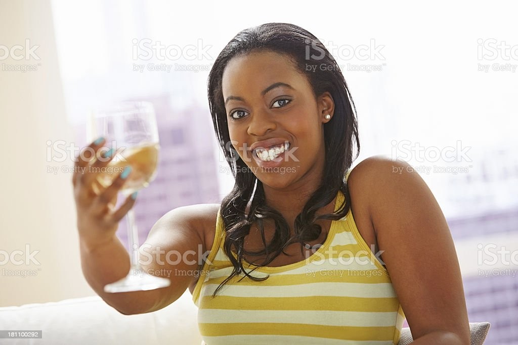 Attractive young woman toasting a wine glass royalty-free stock photo