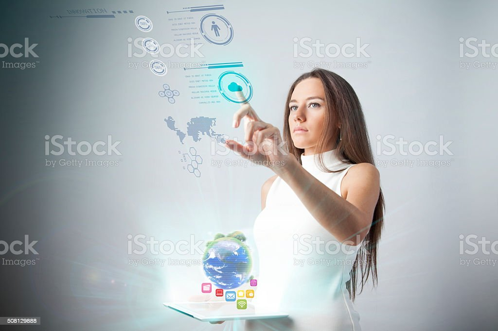 Attractive young woman using new technologies stock photo