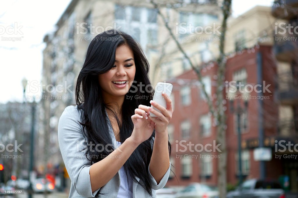 Attractive young woman using smartphone royalty-free stock photo
