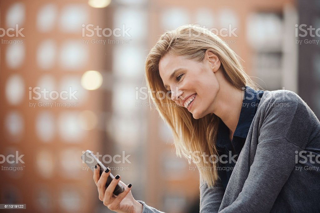 Attractive young woman using smartphone stock photo