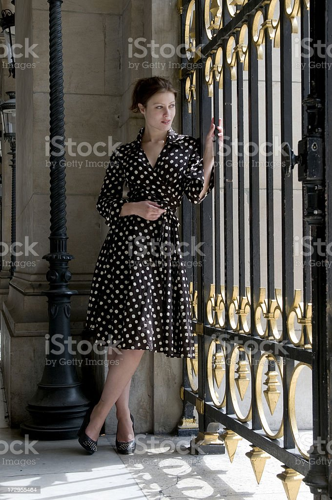 attractive young woman waiting at gate royalty-free stock photo