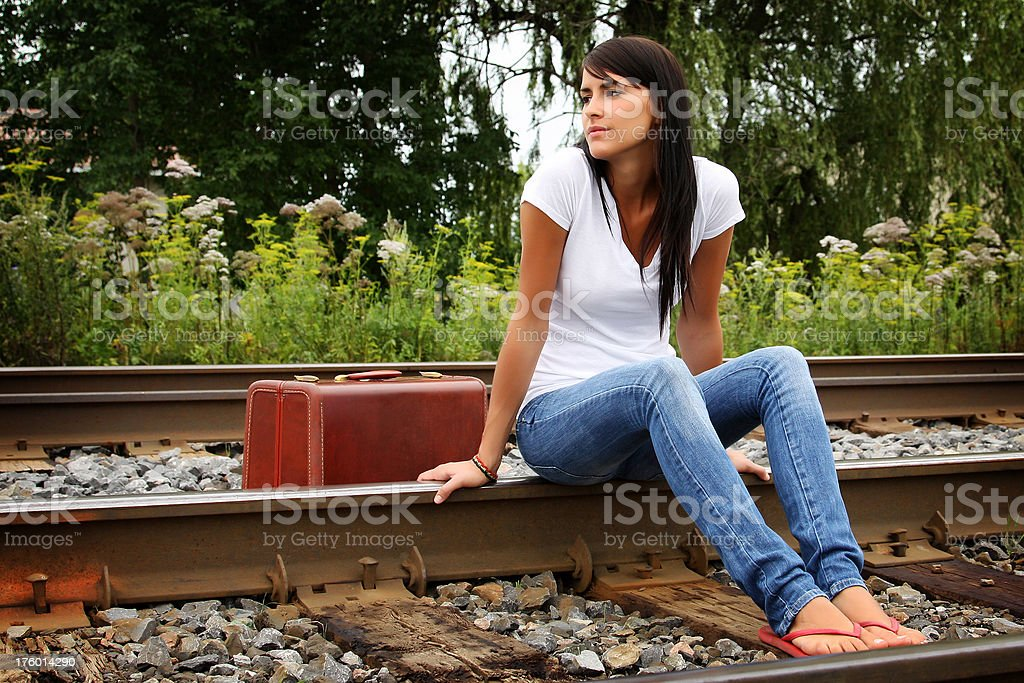 Attractive young woman waiting for the train royalty-free stock photo