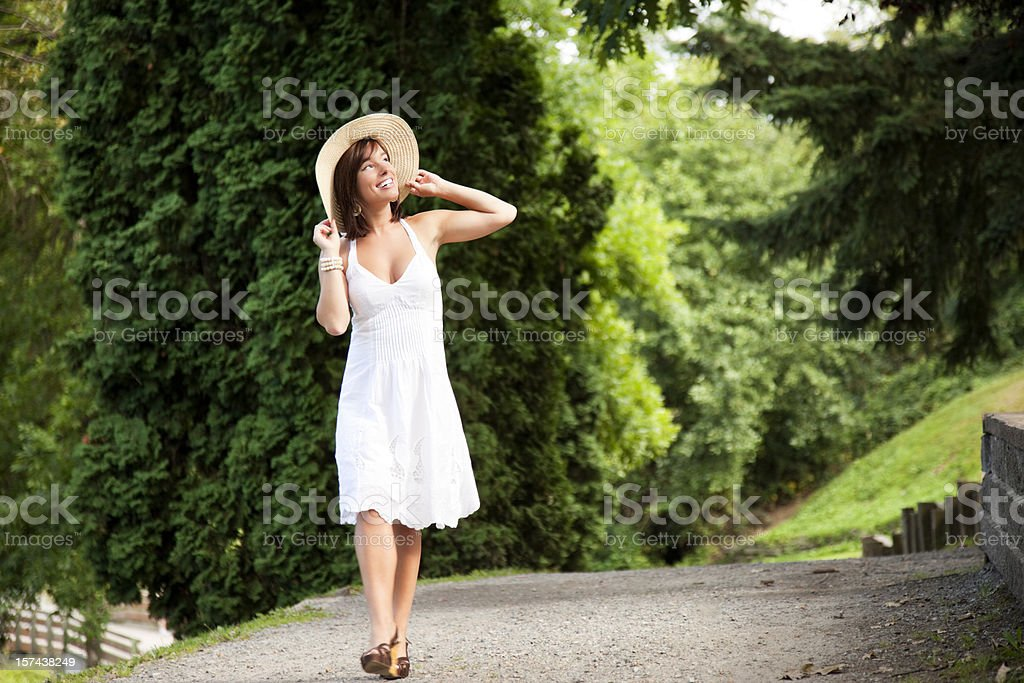 Attractive Young Woman Walking in The Park royalty-free stock photo