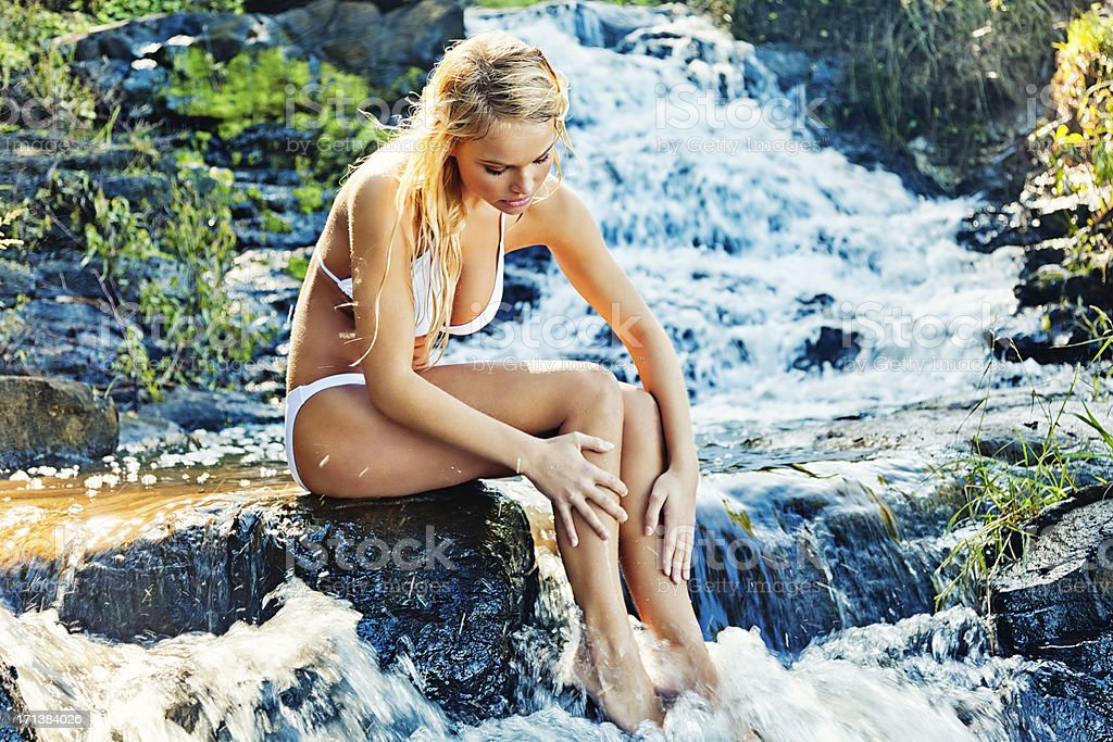 Attractive Young Woman Washing Self in Stream royalty-free stock photo