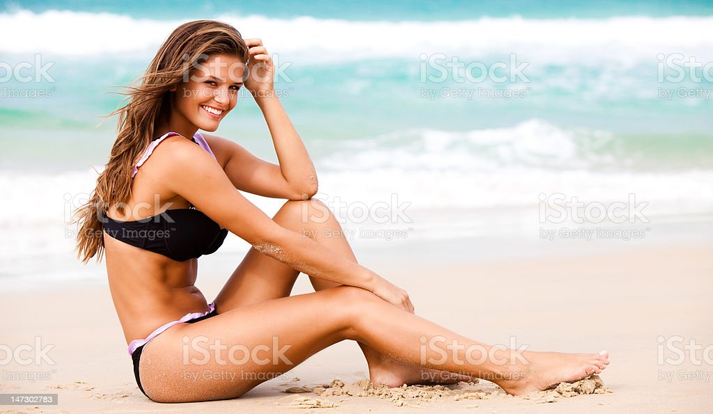 Attractive Young Woman Wearing a Black Swimsuit stock photo