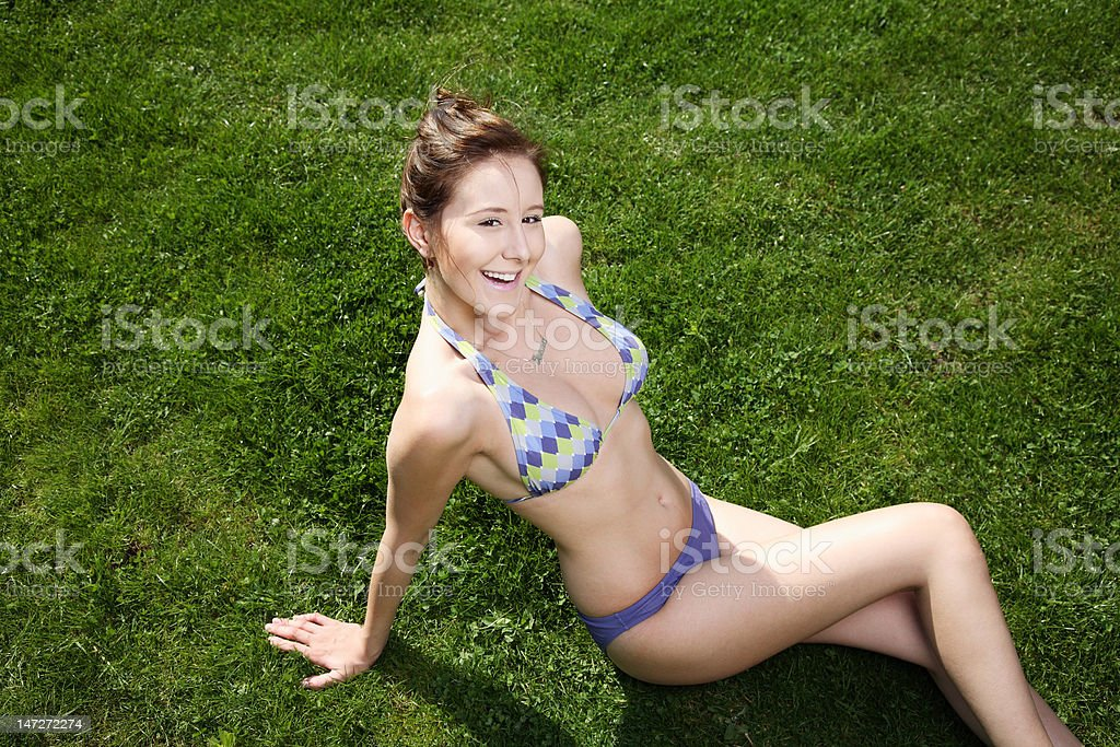 Attractive young woman wearing bathing suit. stock photo
