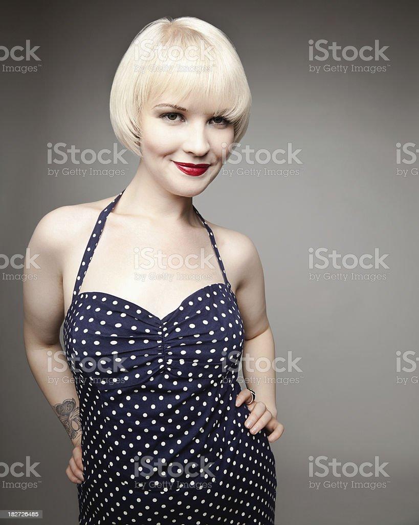 Attractive Young Woman Wearing Polka Dot Dress royalty-free stock photo