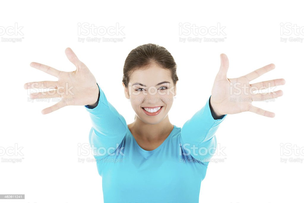 Attractive young woman wiht hands open in front on her. stock photo