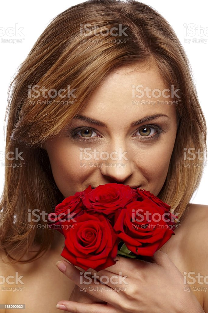 Attractive young woman with bunch of roses royalty-free stock photo