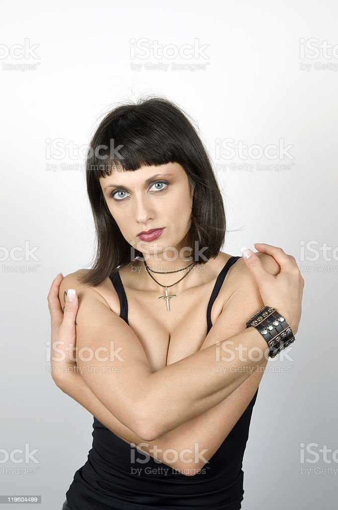 Attractive Young Woman with Crossed Arms royalty-free stock photo