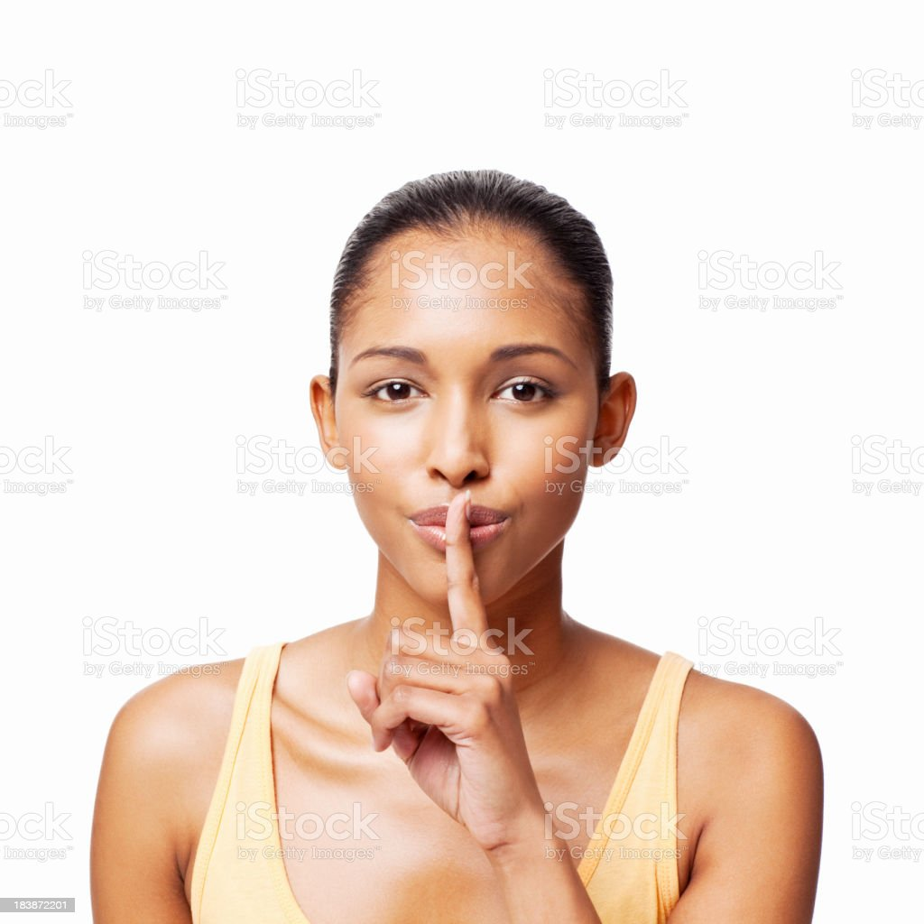Attractive Young Woman With Finger to Lips - Isolated stock photo
