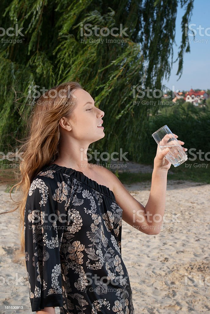 Attractive young woman with glass of water royalty-free stock photo