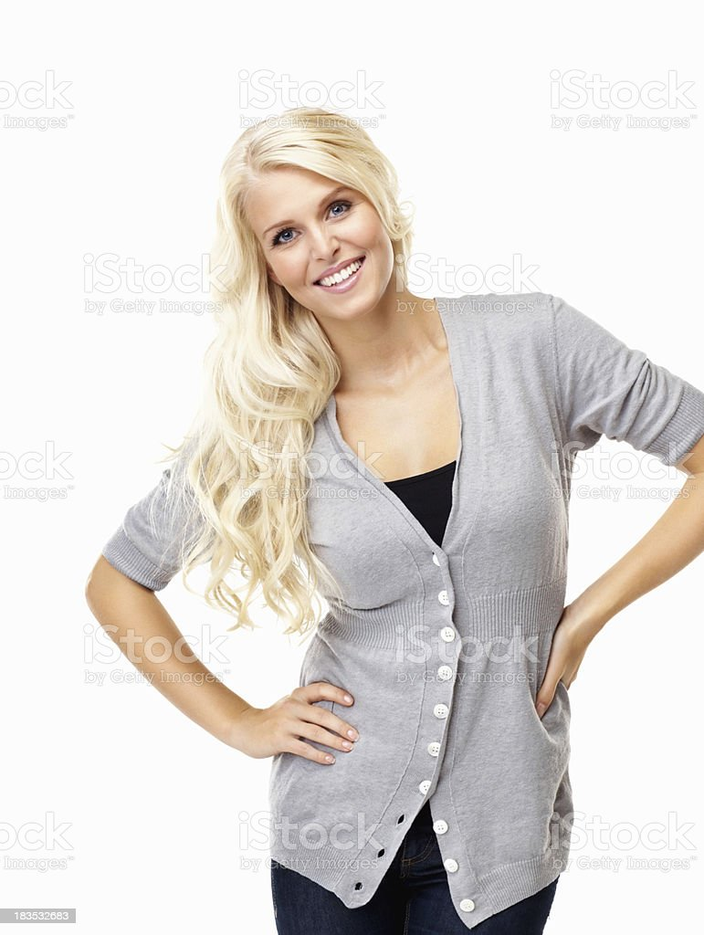 Attractive, young woman with hands on hips against white royalty-free stock photo