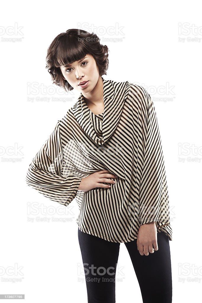 Attractive Young Woman with Hands on Hips stock photo