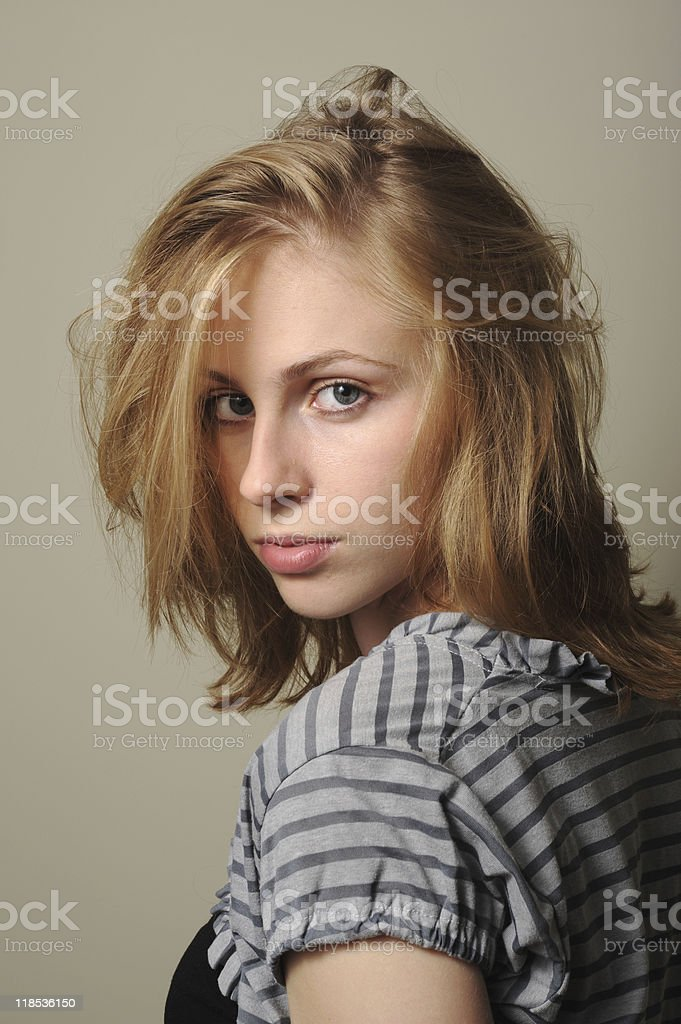 Attractive young woman with intense look royalty-free stock photo