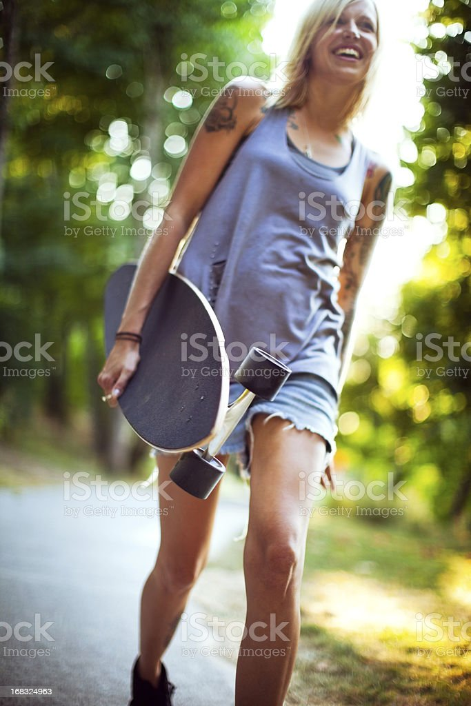 Attractive Young Woman with Longboard royalty-free stock photo
