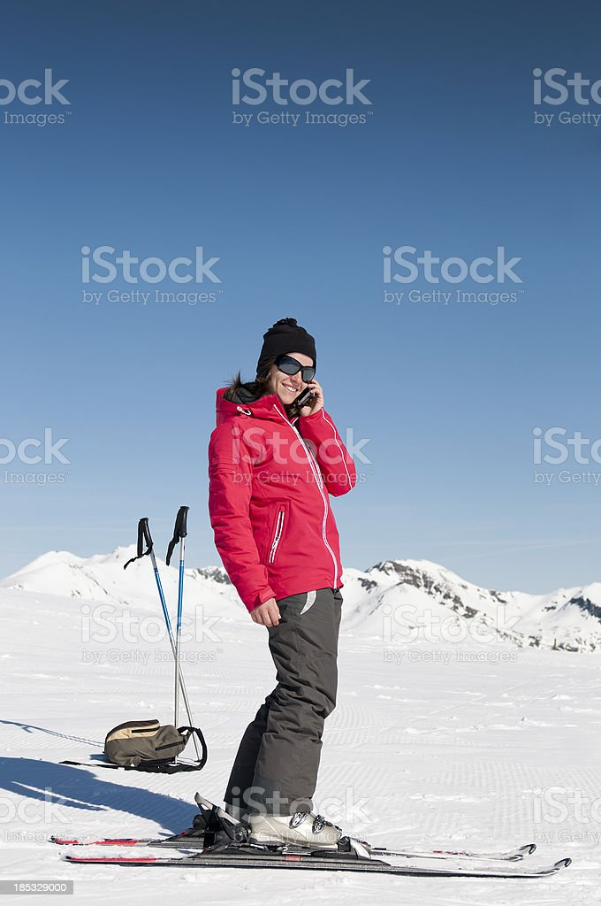 Attractive young woman with skiis on royalty-free stock photo