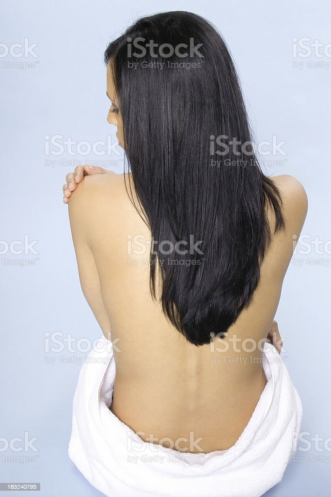 Attractive Young Woman Wrapped in a Towel royalty-free stock photo