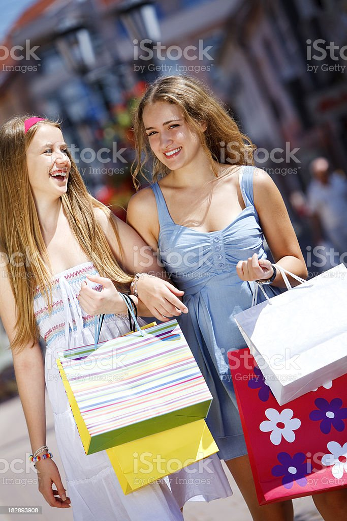Attractive young women shopping royalty-free stock photo