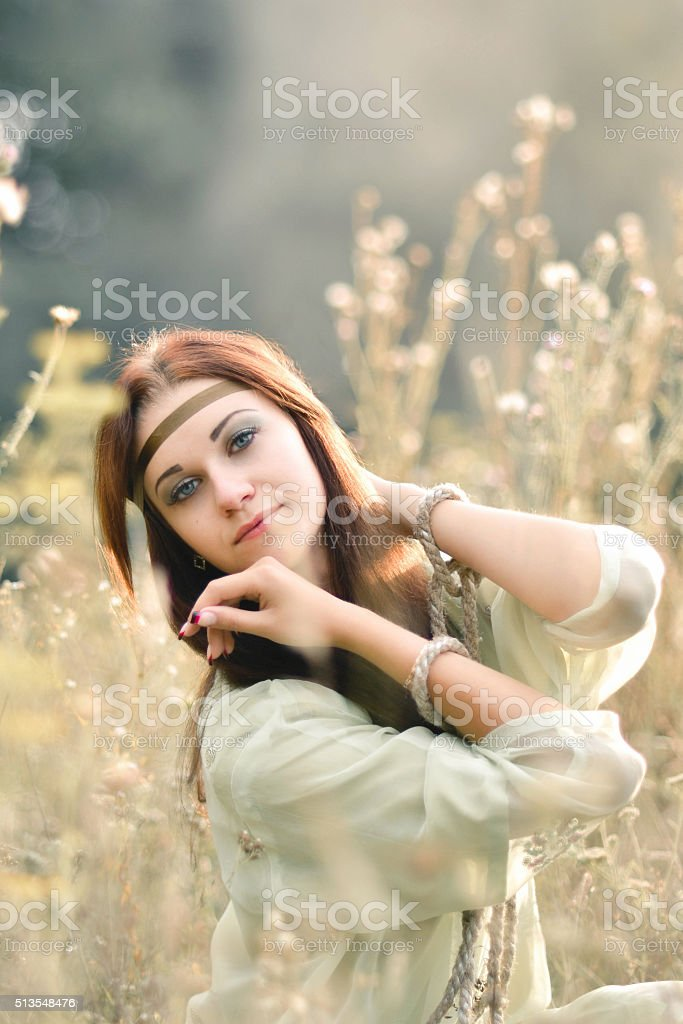 Attractive,charming,exquisite,lovely,red-haired girl in sunny summer field stock photo