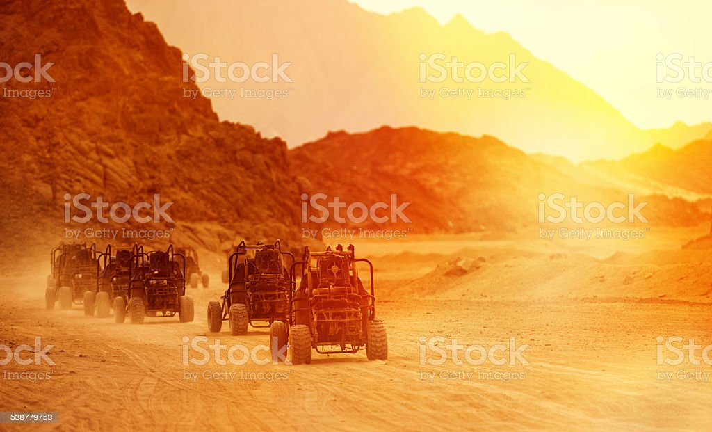 atv in dessert stock photo