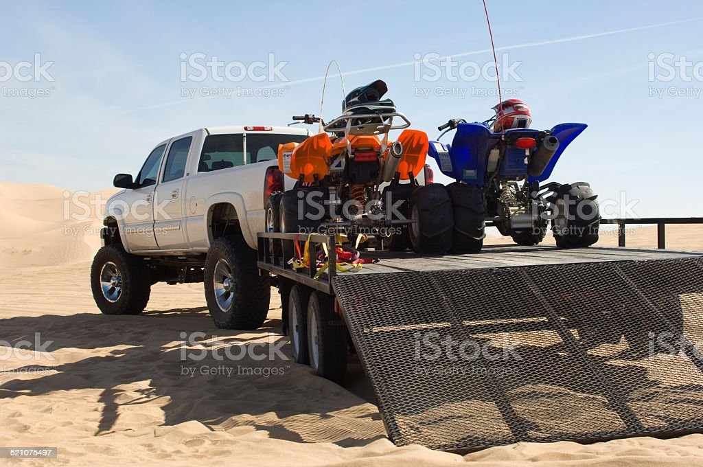 ATVs on Trailer Behind Pickup Truck stock photo