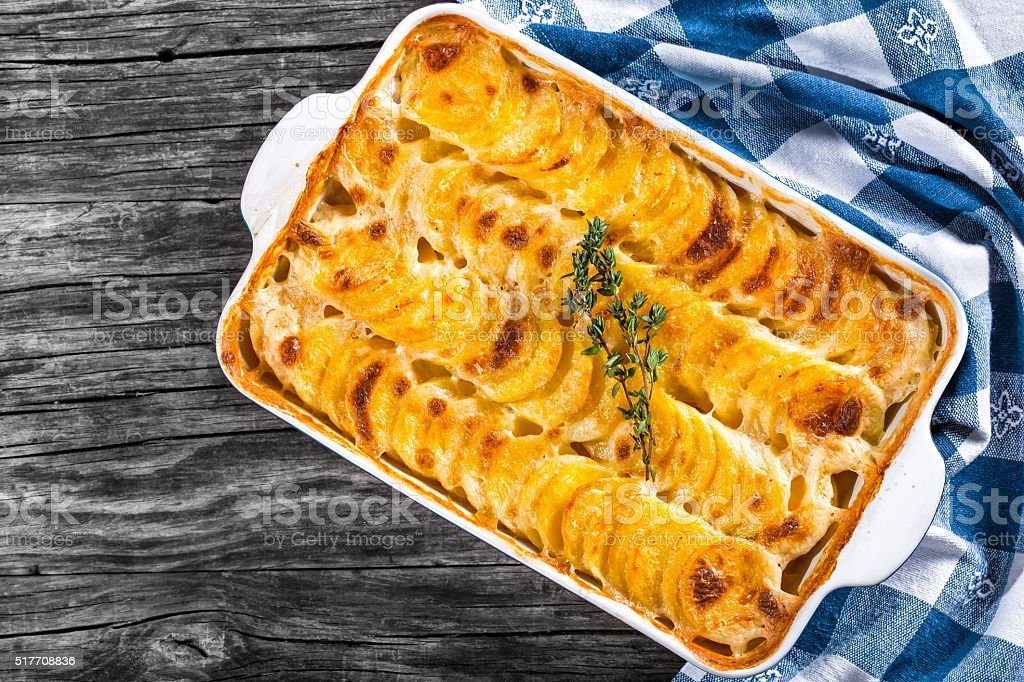 Au Gratin Dauphinois, Potatoes baked in a baking dish, close-up stock photo