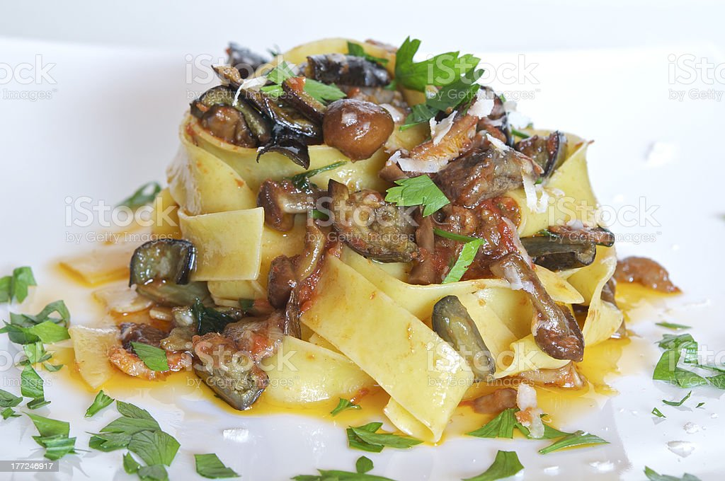 Aubergines and mushroom pappardelle pasta stock photo