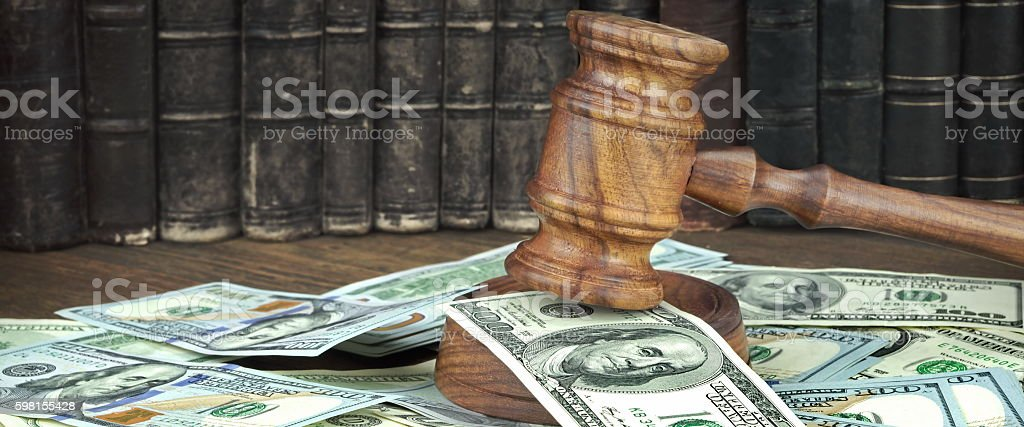 Auction Or Trial Concept With Judges Gavel And Money Heap stock photo