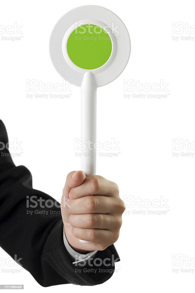 Auction paddle or voting card in hand stock photo