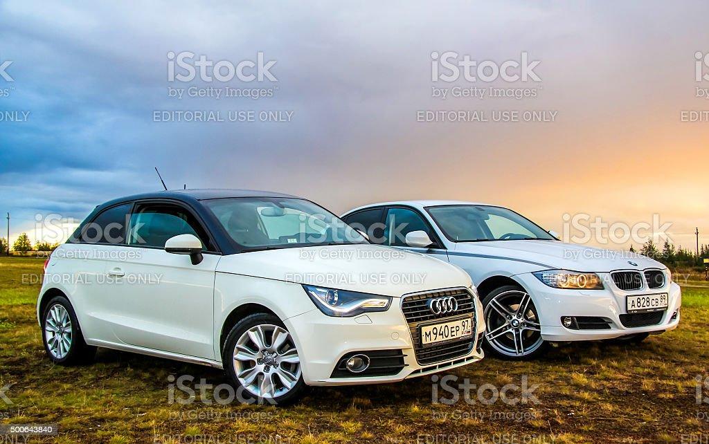 Audi A1 and BMW E90 318i stock photo