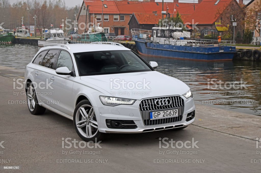 Audi A6 Allroad on the street near the river channel stock photo