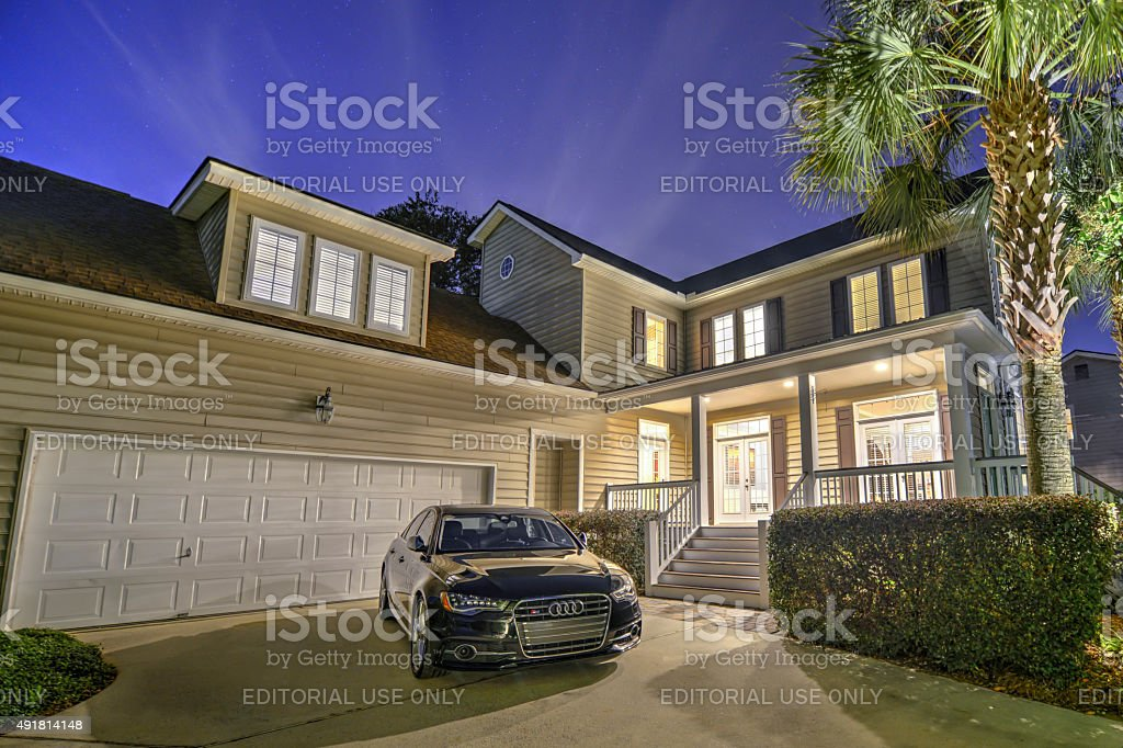 Audi in Front of House stock photo