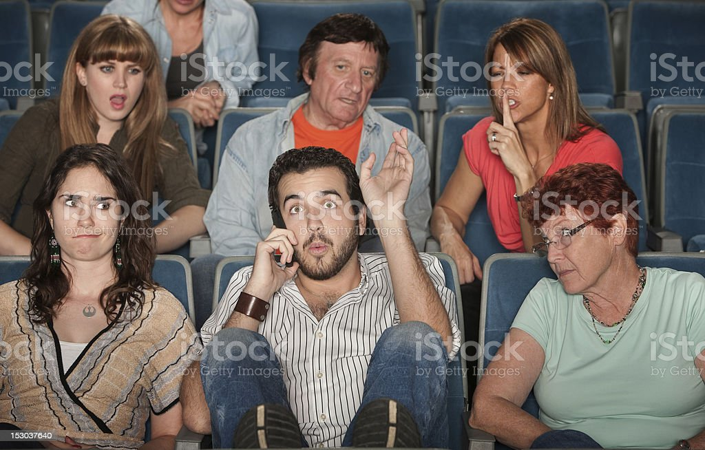Audience Angry With Man on Phone royalty-free stock photo