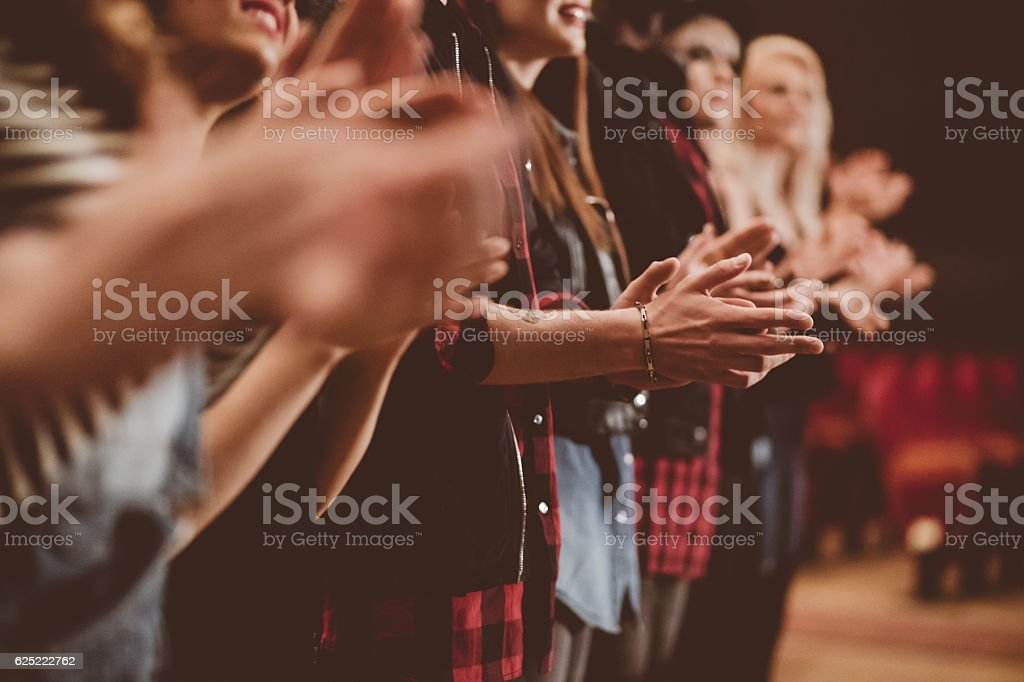 Audience applauding in the theater stock photo