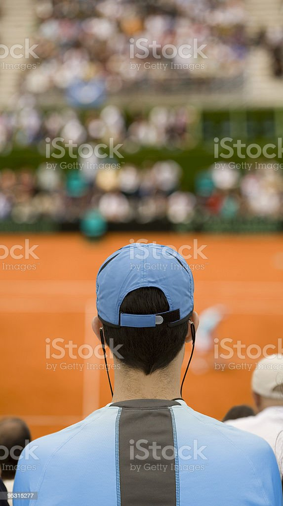 Audience at tennis match stock photo