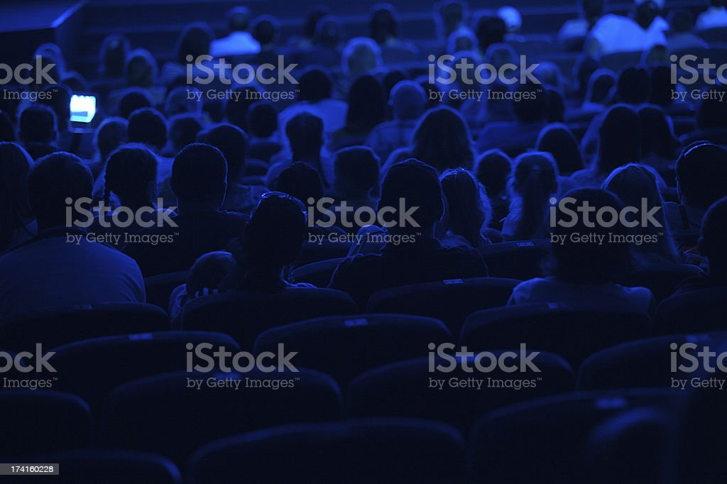 Audience in the cinema. Silhouette. stock photo
