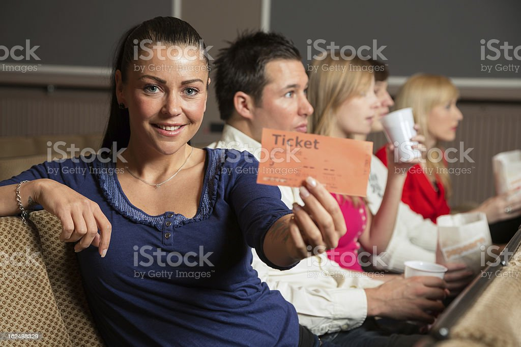 Audience member presenting tickets royalty-free stock photo