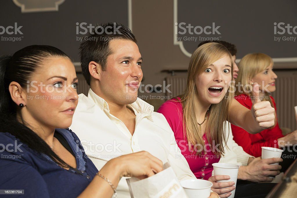 Audience members showing thumbs up royalty-free stock photo