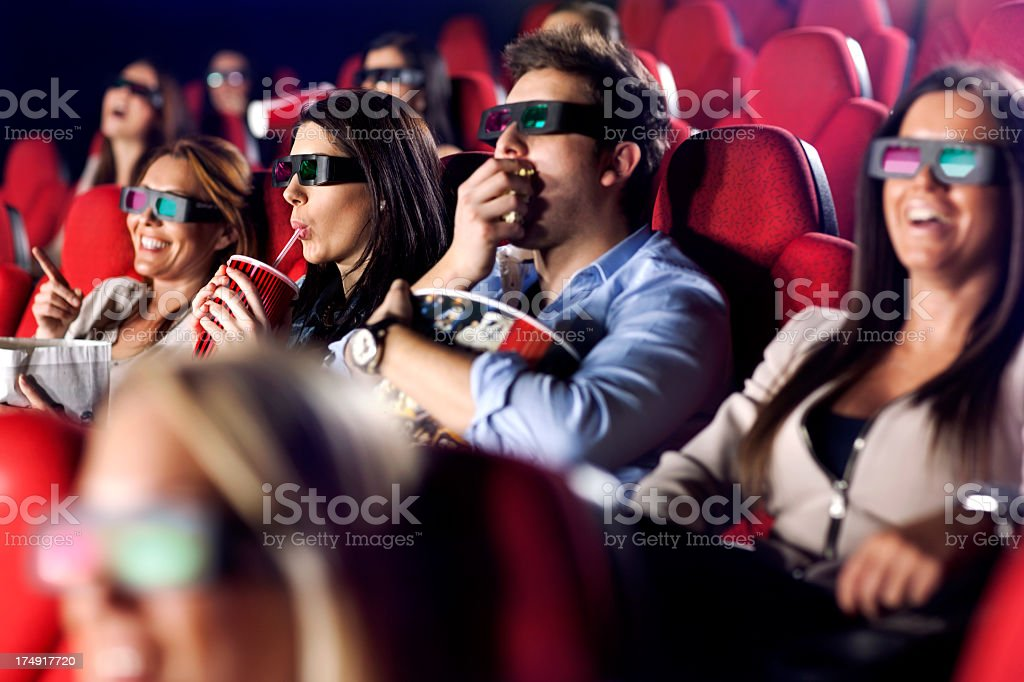 Audience Watching  Movie with 3-d glasses stock photo
