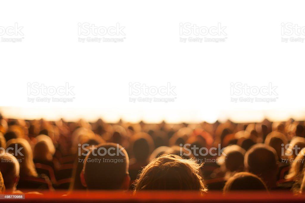 audience watching theater play stock photo