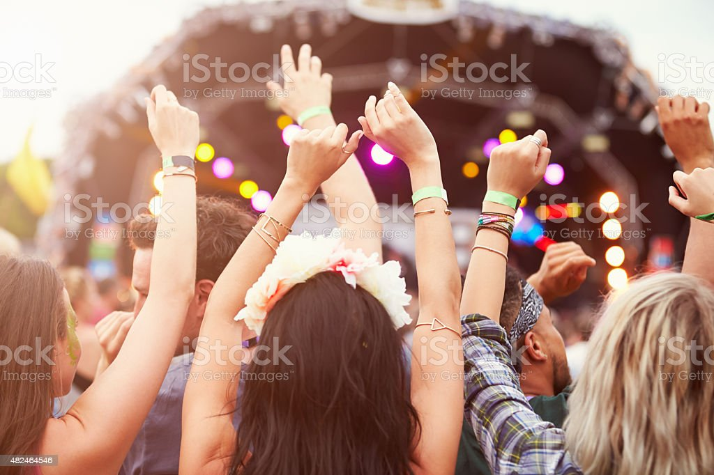 Audience with hands in the air at a music festival stock photo