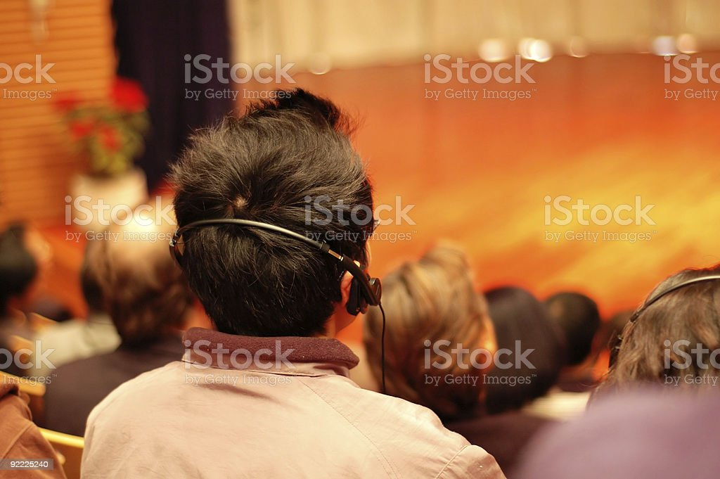 Audiences attending a presentation stock photo
