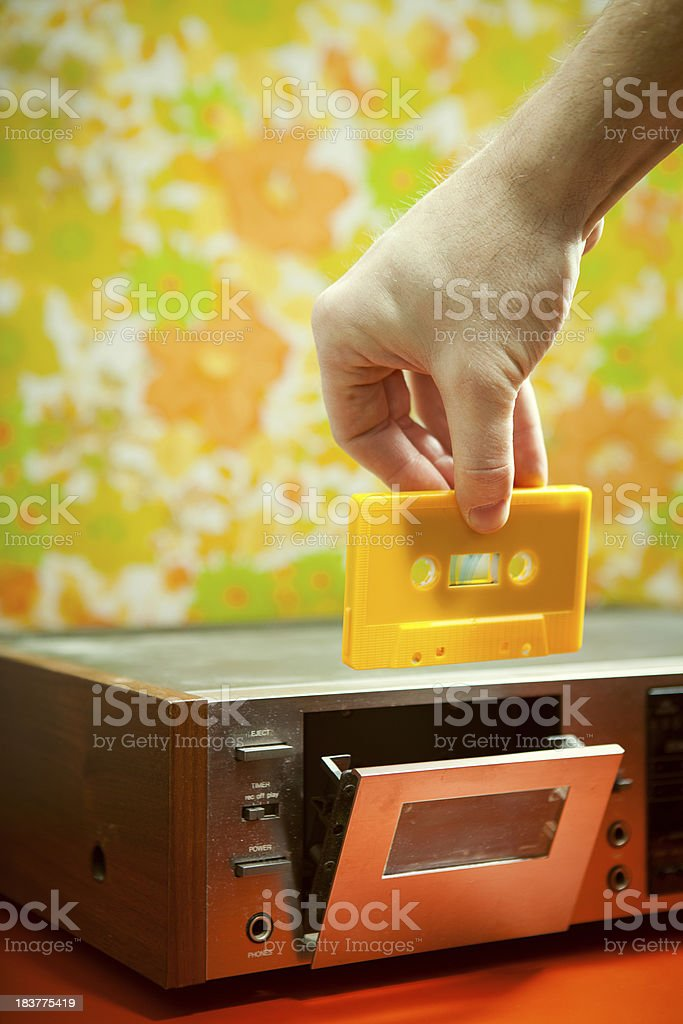 Audio Cassette and Tape Player with Floral Wallpaper stock photo