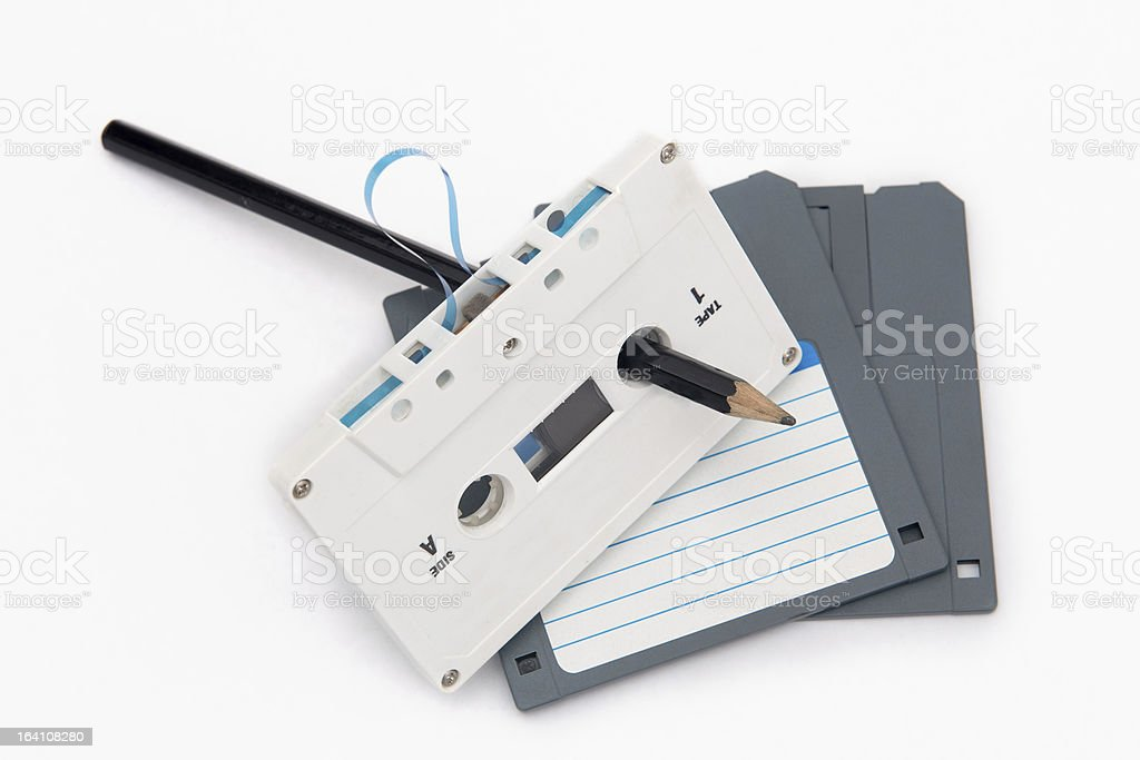 Audio cassette tape and computer floppy disks royalty-free stock photo
