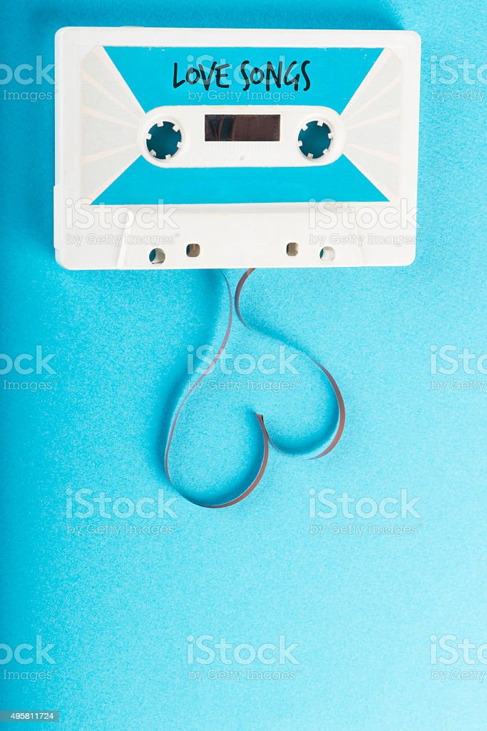 Audio Cassette Tape on Blue Background stock photo