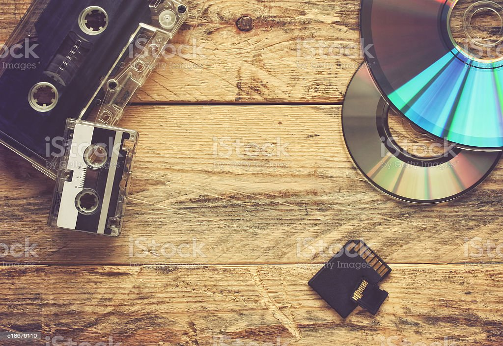 audio cassettes and cd discs and flash cards stock photo