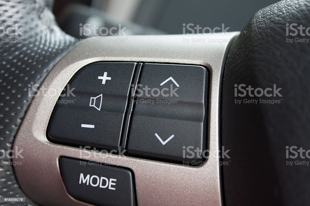 Audio control buttons on the steering wheel of modern car stock photo