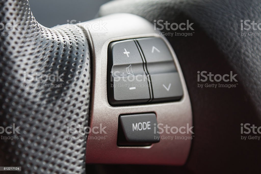 Audio control buttons on the steering wheel stock photo