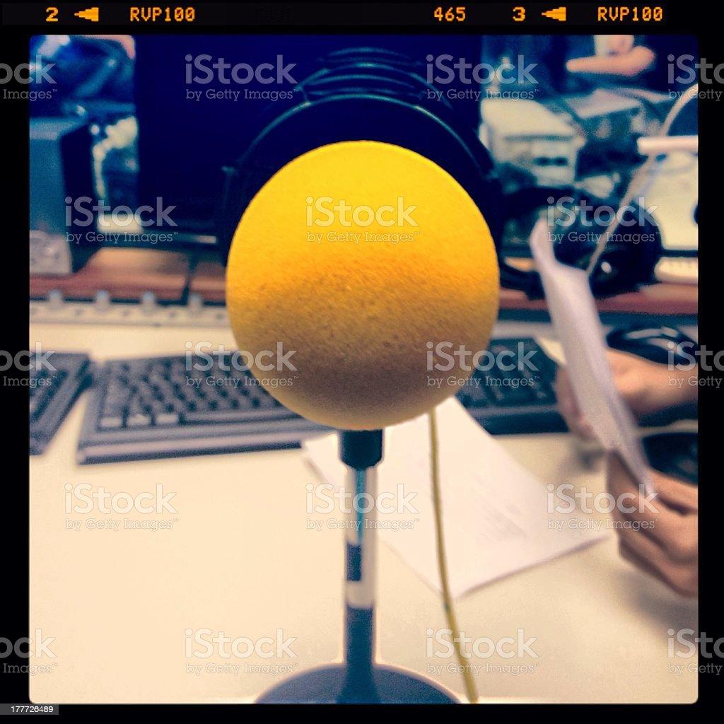Audio journalism representation with yellow mini microphone stock photo